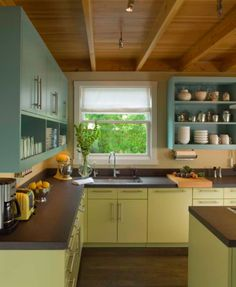 Unique colour combination and open cabinets in the kitchen.