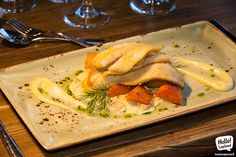 Lappish perch with root vegetables and parsnip puree enjoyed at traditional Nili restaurant in Rovaniemi.