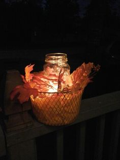 Made from basket, napkins and leaves bought at the dollar store and an empty jar of pasta sauce
