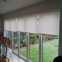 Battery operated roller blinds with Mermet Fabric neatly concealed behind an aluminium pelmet by Deans Blinds & Awnings call us on 020-8947-8931