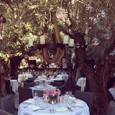 Love the ball glasses hanging out from the trees , also the candles on the chandelier
