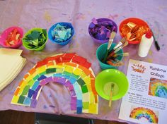 Rainbow collages - simple craft for preschoolers. White cardboard rainbow shape, coloured collage materials. (Dapto Messy Church, Feb 2013)