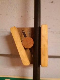 Idea for a broom holder by Adrian Gonzalez on Facebook via Woodworking for Mere Mortals.