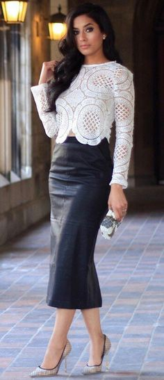 Black leather skirt, white lace eyelet blouse, white / black trim heels & coordinated mini clutch.