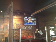 TV mounted on a brick wall inside of a restaurant. Cable box is installed behind the TV connected to an IR repeater to change channels. Hide Tv Wires, Hide Cables, Tv Wall Mount Bracket, Wall Mounted Tv, Concrete Wall, Brick Wall, Tv Wall Mount Installation, Hidden Tv, Cable Box