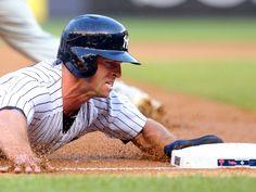 New York Yankees center fielder Brett Gardner slides into third during the first inning against the Philadelphia Phillies in New York. The Phillies won 11-8.  Brad Penner, USA TODAY Sports