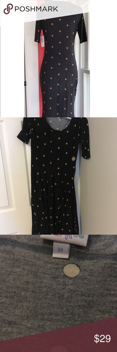 LULAROE JULIA POLKA DOT DRESS M First pic is an example of the pattern, not the actual dress. Size M, EUC. Make me an offer or bundle for my personal discount! LuLaRoe Dresses Midi