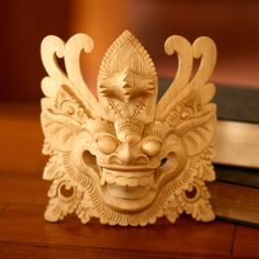 The Barong mask is a critical part of the Barong dance, one of Bali's most important religious traditions. ceremonies and enters the body of a medium. The medium falls into a trance and dances the Barong dance. Hand-carved from crocodile wood.