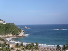 One of my favorite places: Huatulco, Oaxaca, Mexico...Joe bought oysters by the rocky area to the left