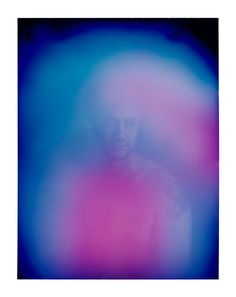 """Photographer Carlo Van de Roer has been shooting portraits with the Polaroid Aura Camera. Created in the 1970's by a gentleman named Guy Coggins, the aura camera was designed to capture more that what can be seen with your human eyes. So, how exactly does this work? The subject puts his or her hands on sensors that measure electromagnetic biofeedback (note: this is the first time the term """"electromagnetic biofeedback"""" has been used on Fstoppers...I checked)."""