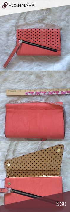 Melie Bianco Angela Purse NWT. Coral colored clutch purse. Has silver colored chain to convert it in to a shoulder bag.  Magnetic closure. Faux leather. Offers and questions are welcome. No trades. Melie Bianco Bags
