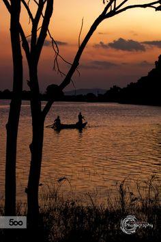 02 people fishing in Kandalama Lake in Sri Lanka