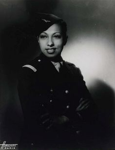 Josephine Baker in her World War II Uniform, c. 1945. During World War II, she worked with the French resistance movement.  Using her career as a cover, Baker carried secret messages written in invisible ink on her sheet music!!