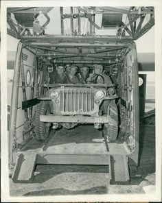 #Jeep and soldiers loaded up in a glider. Circa: 2/24/1943