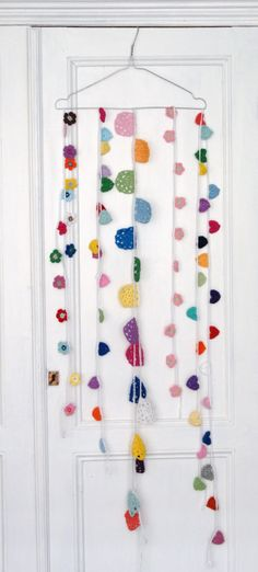 DIY colorful garland strands for decoration, but hung out of reach.