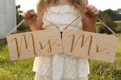 Set of Mr. and Mrs. laser cut and engraved signs adorned with jute twine hangers.  Perfect to use as chair signs, photo props and more.!