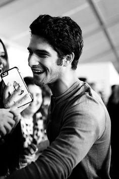 Actor Tyler Posey takes a selfie with fans at the People's Choice Awards 2016 at Microsoft Theater on January 6, 2016 in Los Angeles, California.