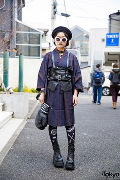 15-year-old Moeka on the street in Harajuku wearing a leather harness over a vintage kimono, Glad News boxing glove bag, and Demonia boots from Never Mind the XU.