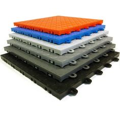 The best interlocking garage floor tile on the market at the best prices. This snap together modular garage flooring option is available in coin top surface pattern design. Use this floor tile for garage floors, trade show and events floors indoors and out of the sun. For exterior installations choose a perforated floor tile. #garageflooring #garagefloortiles