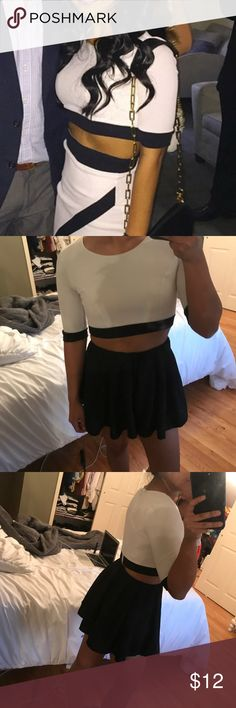 Lulu's Black and White Short Sleeve Crop Top Adorable color block crop top! Tagged Nasty Gal for Exposure  This was part of a set-I no longer have the skirt. Shoulder to bottom: about 13inches (pictured) and all around the bottom: about 24inches but stretches up to about 29inched!  In good condition worn only a few times!  There appears to some wear on zipper and minor stains on 1 of the sleeves that a regular wash did not get out but I'm sure a stain remover would get them out (pictured)…