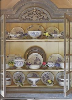 Great cabinet of blue and white china with pewter charger.