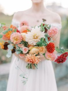 Fall botanic garden wedding with colorful flowers by Wild Fleurette, Virginia & destination wedding and event florist, seasonal autumn bridal bouquet in cream, orange , gold, red, peach, pink and burgundy featuring dahlias, garden roses, honeysuckle, and cosmos, lush and gathered hand tied bouquet | Madeleine Deighan Photography | Venue | Lewis Ginter Botanical Garden | Florals | Wild Fleurette | Dress | Here and Now Bridal | HMUA | Anna Breeding