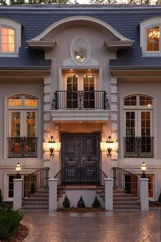 I love the facade of this home… the double staircase, arched transoms, and wrought iron balconies are very European. You could easily imagine seeing a building like this on a Paris street.  (via New Residential Homes - traditional - exterior - minneapolis - by Hendel Homes, Rick & Amy Hendel)