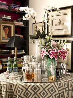 bar carts, trays and now tables... definitely a not-so-recent obsession.  this one is made perfect by the amazing orchid, layered art and bookcase, and La Fiorentina fabric.