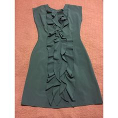 Classy, Ruffled dress This is a beautiful dress that accents your figure wonderfully! Color is more teal than blue. Dress has belt option. Olivia Matthews Dresses High Low