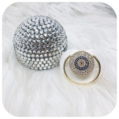 Crystal sparkle evil eye pacifier case that holds our luxury baby pacifiers and clip sets. Visit our luxury baby accessories boutique for luxury baby pacifiers and clip sets. Fashion baby essentials, newborn must-haves, and luxury baby products with style. Check out our glam baby gift ideas in our online store! Shop now at lioree.com #newborngifts #newbornmusthaves #babygiftideas #babygiftsets #babypacifiers #pacifiercase Baby Gift Sets, Baby Gifts, Baby Baby, Bling Pacifier, New Born Must Haves, Chicco Baby, Baby Accessories, Fashion Accessories, Baby Swag