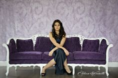 Purple Couch - midtoned purple on a lilac wall with white and grey
