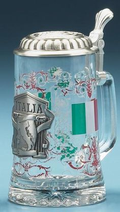 The Italian flag colors of red/white/green are high-fired in a detailed transparent pattern on the glass body of the stein, suggesting famous Roman architecture with vine German Beer Glasses, German Beer Mug, German Beer Steins, Italian Flag Colors, Beer Maker, Beer 101, Nutcrackers, Beer Mugs, How To Make Beer