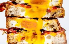 Turn your egg-in-a-hole into a grilled cheese sandwich. With bacon.