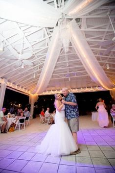 This beautiful moment at this Anna Maria, FL beach pavilion was planned at floridaweddings.com. See more wedding ideas, beach weddings, and wedding decor on our website. We make a Florida beach wedding simple and affordable so you can focus on what matters most.
