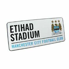 "Manchester City FC. ""Etihad Stadium"" Metal Street Sign by Manchester City F.C.. $10.99. Manchester City F.C.. Official Licensed Product. Approx 40cm x 18cm. Metal Street Sign. MANCHESTER CITY F.C. Metal Street Sign Approx 40cm x 18cm Official Licensed Product"