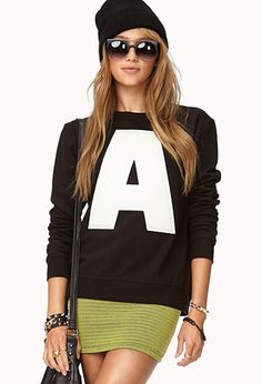 "A sweatshirt featuring an ""A"" graphic. Round neckline. Long sleeves. Ribbed trim.  http://foxyblu.com/details/138599"