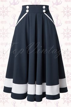 The50s Petra Sailor Swing Skirt in Navyby Miss Candyfloss is a real must-have for fifties marine lovers! An elegant fifties inspired swing skirt withcute retro sailor details like the contrasting white trims, white fabric button detailing at the waistband and the broad white stripe at the hem.Beautifully fitted at the waist from which it runs into a flattering full swing skirt which can be paired with one of our petticoats for an extra festive effect, ...