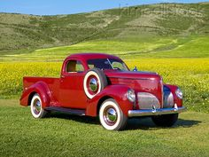 1939 Studebaker Coupe Express Cabernet 3/4 Front View On Grass By Wildflowers And HillsPhotographer:Ron Kimball/KimballStock