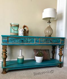 So many beautiful colors to this piece. Stormy Seas, gel stain Temptress, Mermaids Tail with a wash of Bunker Hills Blue and wash of Farmhouse Green. The drawers were done with Copper Patina paint with blue and green spray and the legs were painted with Coffee Bean and then Iron paint in random areas with green spray.