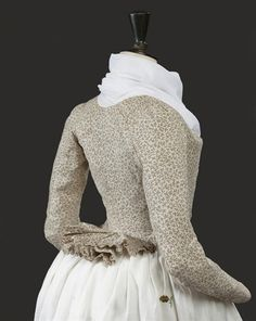 """Caraco jacket, Europe, c. 1790. White cotton printed with a brown leaf meander."""