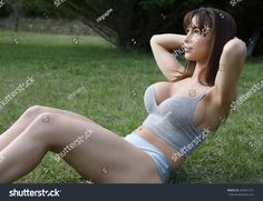 https://image.shutterstock.com/z/stock-photo-sexy-girl-with-a-large-breast-doing-crunches-outdoor-646551721.jpg