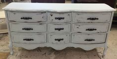 """Here is a big French 9 drawer dresser. I painted it a really light blue which you can't see that well :( so I included a color chip as well. What do you think?  The dimensions are 64"""" L, 19"""" W, 32"""" H. SOLD!! for $350"""