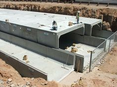 Type II wide x high center box culvert cell adjoined with two wide high end cells, El Mirage Rd. Phase B Project, El Mirage, Arizona. Underground Shelter, Underground Homes, Concrete Houses, Precast Concrete, Concrete Building, Survival Shelter, Survival Prepping, Survival Gear, Doomsday Bunker