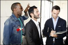 Kanye West photobombing Marc Jacobs.
