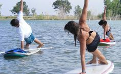 Paddle board yoga! This looks like an awesome workout and a good way to get a tan while getting fit!