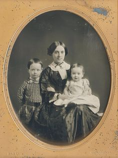 Smiling young mother with two children, 1840s daguerreotype