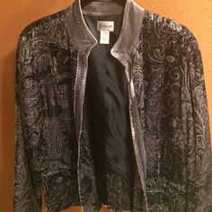 Chicos Grey/Black Jacket size 1 (size 6/8) NWOT Pure elegance. All you need are black slacks (or great dark jeans!) and a simple top underneath and you are set. This jacket is NWOT, and it has a beautiful paisley pattern with a feint silver sparkle interwoven the sleeves the the from is beautifully lines with grey velvet and stitching. The whole jacket is a beautiful, thin-knit velvet. Chico's Jackets & Coats