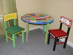 Hand-painted children's table   Acrylic paint with sealer on solid wood  Two chairs for the girls