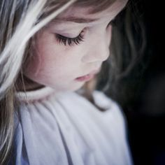 Little girl in thought. Love the angle of this picture. Captures her profile perfectly.