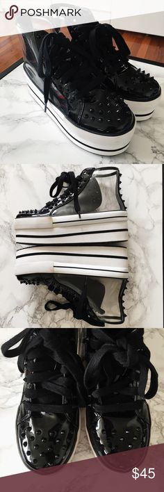 """YRU Clear Black Platform Sneakers Size 7 - YRU Clear Black Elevation Platform Sneakers. Worn twice. There are signs of wear but overall still in good condition.  Small studs on the toe, tongue and back. 2 1/2"""" heel and 2"""" platform. Synthetic upper, man made sole.   Please feel free to make an offer. Also listed on ♍️ercari at a cheaper price. Username """"frannyvilla"""" YRU Shoes Sneakers"""